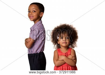 Childhood And People Concept-two Smiling African American Siblings Standing Back To Back With Arms C