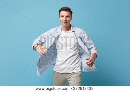 Young Man Guy 20s In Casual Shirt Posing Isolated On Pastel Blue Wall Background Studio Portrait. Pe