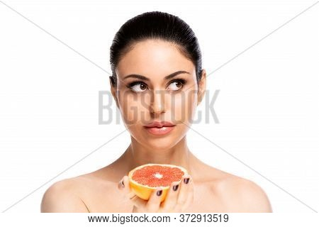 Healthy Food Concept. Beautiful Young Woman Holding Piece Of Grapefruit, Isolated Over White Backgro