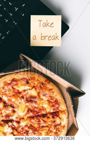 Pizza In Box, Laptop And Sticker With Text Take A Break On Desk In Office. Concept Of Food Or Pizza