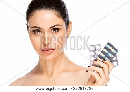 Closeup Portrait Of Brunette Woman With Pills, Isolated. Healthcare And Medical Concept
