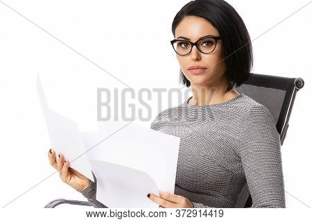 Pensive Young Business Woman In Glasses Sitting On Chair With Paper Documents. Isolated Over White B