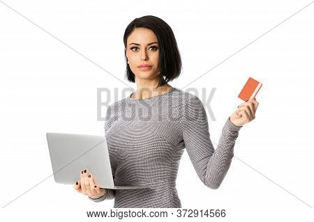 Portrait Of Confident Businesswoman Hold Laptop And Bank Card In Her Hands. Isolated Over White Back
