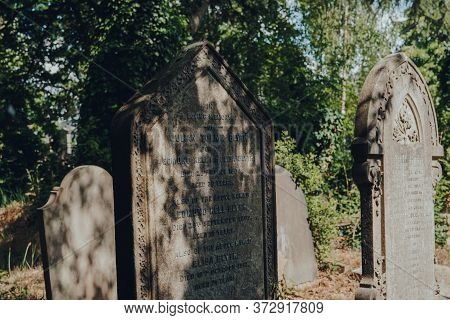 London, Uk - June 16, 2020: Light And Shadow On Tombstones Inside Hampstead Cemetery, A Historic Cem