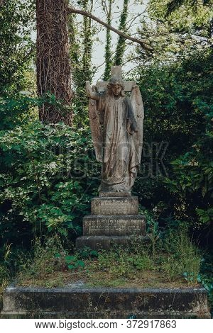 London, Uk - June 16, 2020: Angel Statue On A Tombstone Inside Hampstead Cemetery, A Historic Cemete