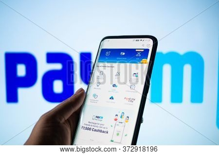 Paytm App Logged In On A Mobile Infront Of A White Screen With Paytm Written