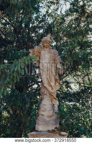London, Uk - June 16, 2020: Angel Statue Against Trees Inside Hampstead Cemetery, A Historic Cemeter