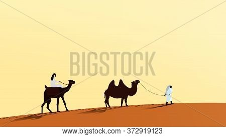 A Caravan Of Camels With People Walking Along The Desert Sand. A Man Rides A Camel. The Second Perso