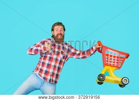 Supermarket. Bearded Man With Empty Shopping Cart. Man On Shopping. Shopping. Sale. Discount. Black