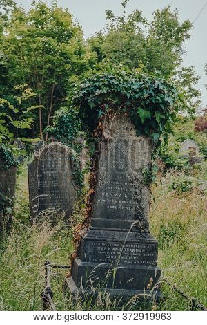 London, Uk - June 16, 2020: Leaning Tombstones Inside Hampstead Cemetery, A Historic Cemetery In Wes