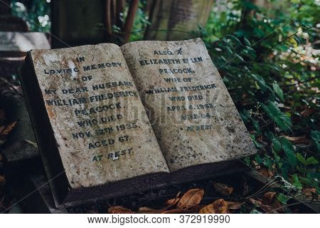 London, Uk - June 16, 2020: Book-shaped Tombstone For Wife And Husband Inside Hampstead Cemetery, A