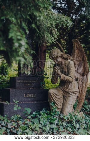 London, Uk - June 16, 2020: Angel Statue By A Tomb Inside Hampstead Cemetery, A Historic Cemetery In