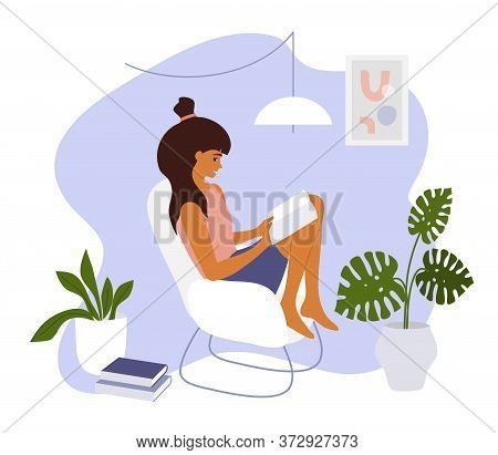Stay At Home. Young Woman Sitting On Armchair With Open Book. Girl Relaxing And Reading In Cozy Mode