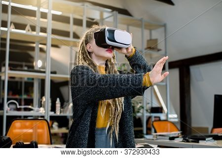 Profession And Job Occupation Concept. Young Creative Woman Architect With Dreadlocks, Testing Vr Vi