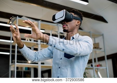3d Technology And Virtual Reality. Young African Dark-skinned Businessman Dressed In Casual Shirt Wi