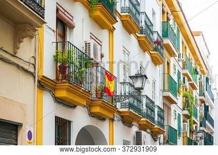 SEVILLA, SPAIN - January 13, 2018: Antique building view in Old Town Seville, Spain