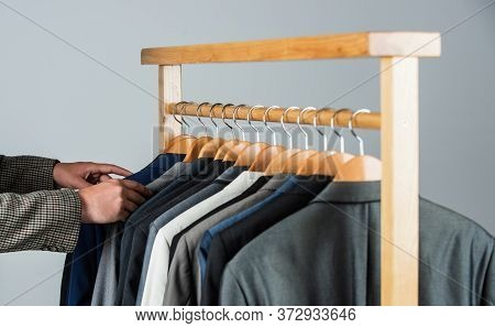 Male Fashion Designer. Individual Measures Hand Of Man. Man Ordering Business Suit Posing Indoor. Ta