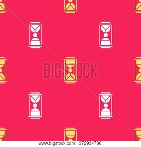Yellow Old Hourglass With Flowing Sand Icon Isolated Seamless Pattern On Red Background. Sand Clock