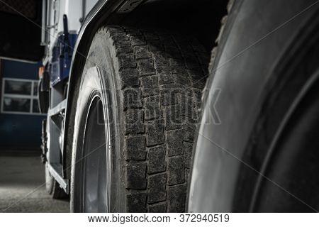 Heavy Duty Transportation Safety. Semi Truck Used Tire Tread Close Up. Transportation Theme.