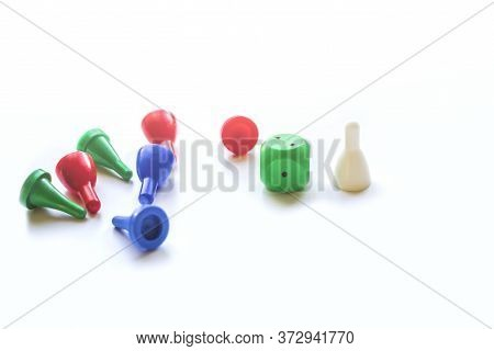 Colorful Play Figures And Plastic Chips With Dice On White Background. Board Games For Children And