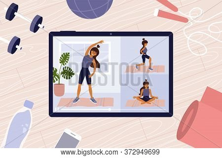 Online Workout Classes On Digital Tablet With Young Woman Showing Exercises. Sport Video. Stay Home,