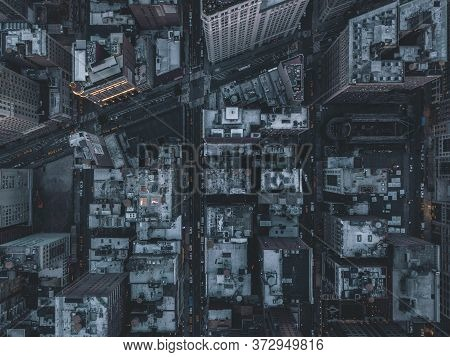 Aerial Overhead View Of Manhattan, New York City Streets Right After Dusk With Street Lights
