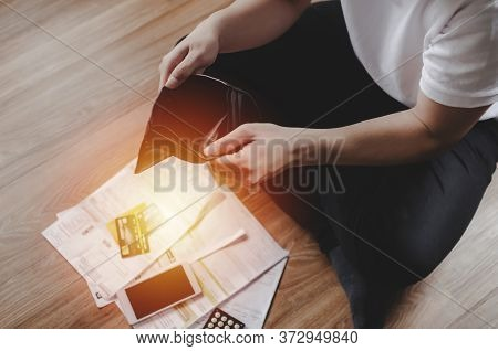 Young Man Hand Open Empty Wallet Sitting On Floor With Family Budget Expense Cost And Credit Card Bi
