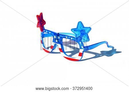 Fashion Sunglasses. American Flag Sunglasses. Isolated on white. Room for text. Fun Holiday Costume Sunglasses. Battery Operated American Flag Flashing Fashion Sunglasses.