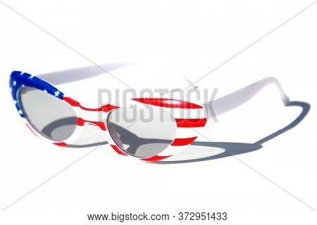 Fashion Sunglasses. American Flag Sunglasses. Isolated on white. Room for text. Fun Holiday Costume Sunglasses. Woman's American Flag Fashion Sunglasses.