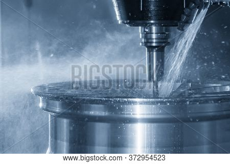 The Multi-axis Machining Center Cutting The Magnesium Alloy Wheel By Solid End Mill Tools. The Hi-te