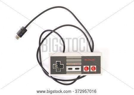 BUDAPEST, HUNGARY - DECEMBER 10, 2017: Nintendo NES classic controller hanging from above. One of the most classic gaming consoles
