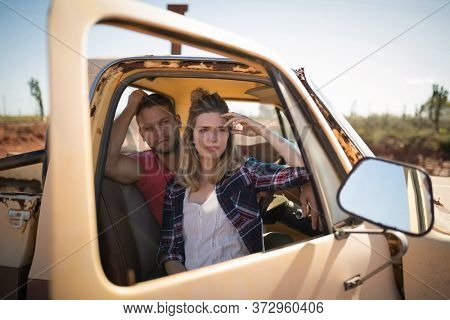 Tensed couple sitting together in a car