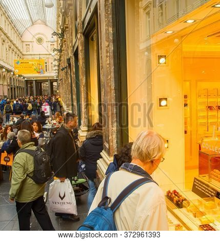 Brussels, Belgium - October 5, 2019: People Choosing Chocolate Candy At St. Hubert Galleries. The Sa