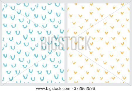 Simple Abstract Spots Vector Patterns. Blue And Yellow Hand Drawn Irregular Brush Spots And Arcs Iso