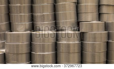 Coils Of Colored Insulating Tape Or Scotch Tape In A Row. Indastrial Grey Tape. Construction Electri
