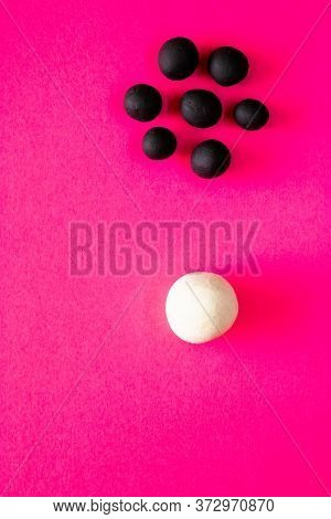 Large White Ball Separated From Many Smaller Black Balls. Plasticine Toys, Concepts Of Racism, White