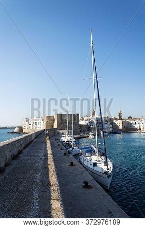 Beautiful Boats In Monopoli Port Near Castle Of Carlo V With Church In Background, Apulia, Bari Prov
