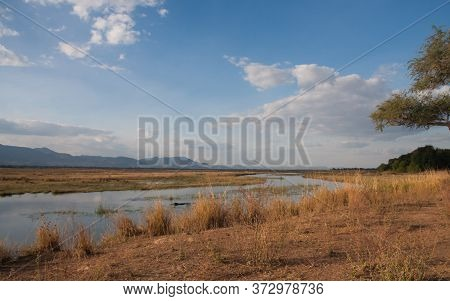 View Of The Zambezi River With Blue Sky And Clouds In Mana Pools National Park, Zimbabwe