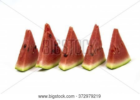 Close - Up Of Several Pieces Of Refreshing Watermelon Isolated On White Background. Fruits Vegetable