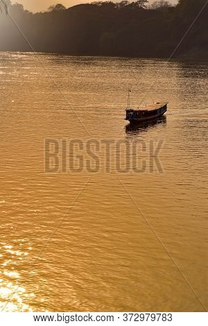 Wooden Boat On A Mekong River At Sunset Luang Prabang Laos