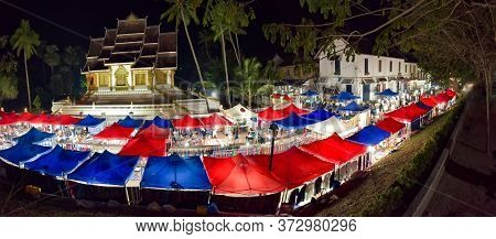 Luang Prabang Night Market Tents In Front Of Haw Pha Bang Temple, Louangphabang Province, Laos