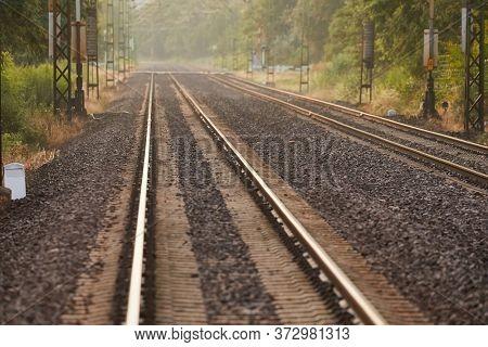 Train line rails railway track with sunlight flare