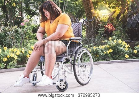 Asian Fat Woman Are Patients Sitting On A Wheelchair She Can't Walk Have A Knee Pain Due To Excessiv