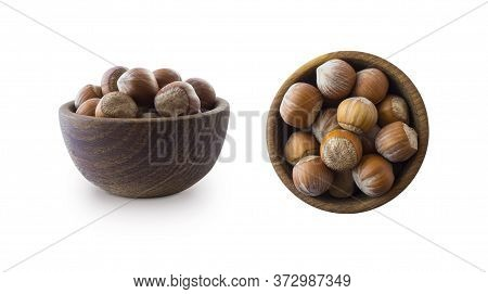 Studio Shot Of Hazelnuts On White Background. Heap Of Hazelnut In Nutshell Isolated On White. Nuts I
