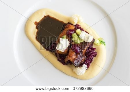 Main Course, Dish With Roasted Pork Belly, Red Sauerkraut And Mashed Potatoes. Demonstration Cooking
