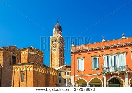 Clock And Bell Tower Of Cathedral Santa Maria Assunta Duomo Roman Catholic Church Building In Chiogg