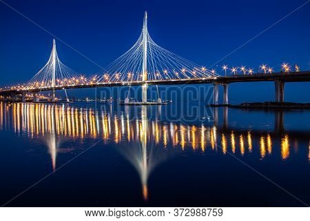 Cable-stayed Bridge Zsd At Night. Modern High Bridge Over The River. Night Landscape Of The City Of