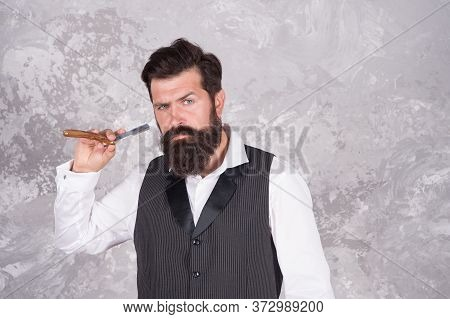 Brutal Hairstylist In Barbershop. Bearded Mature Man Works At Barbershop. Retro Razor. Safety Grip T