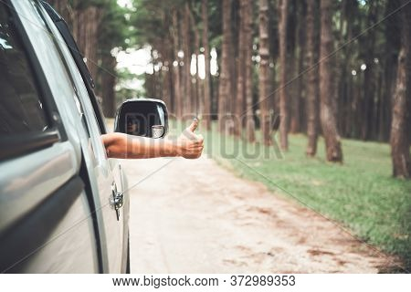 A Man Driving A Pickup Truck, Stretching His Hand Out Of The Car Excellent Symbol While He Was Drivi
