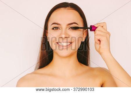 Portrait Happy Beautiful Girl Apply Mascara Cosmetics On Long Perfect Eyelashes Extension, Smile Iso